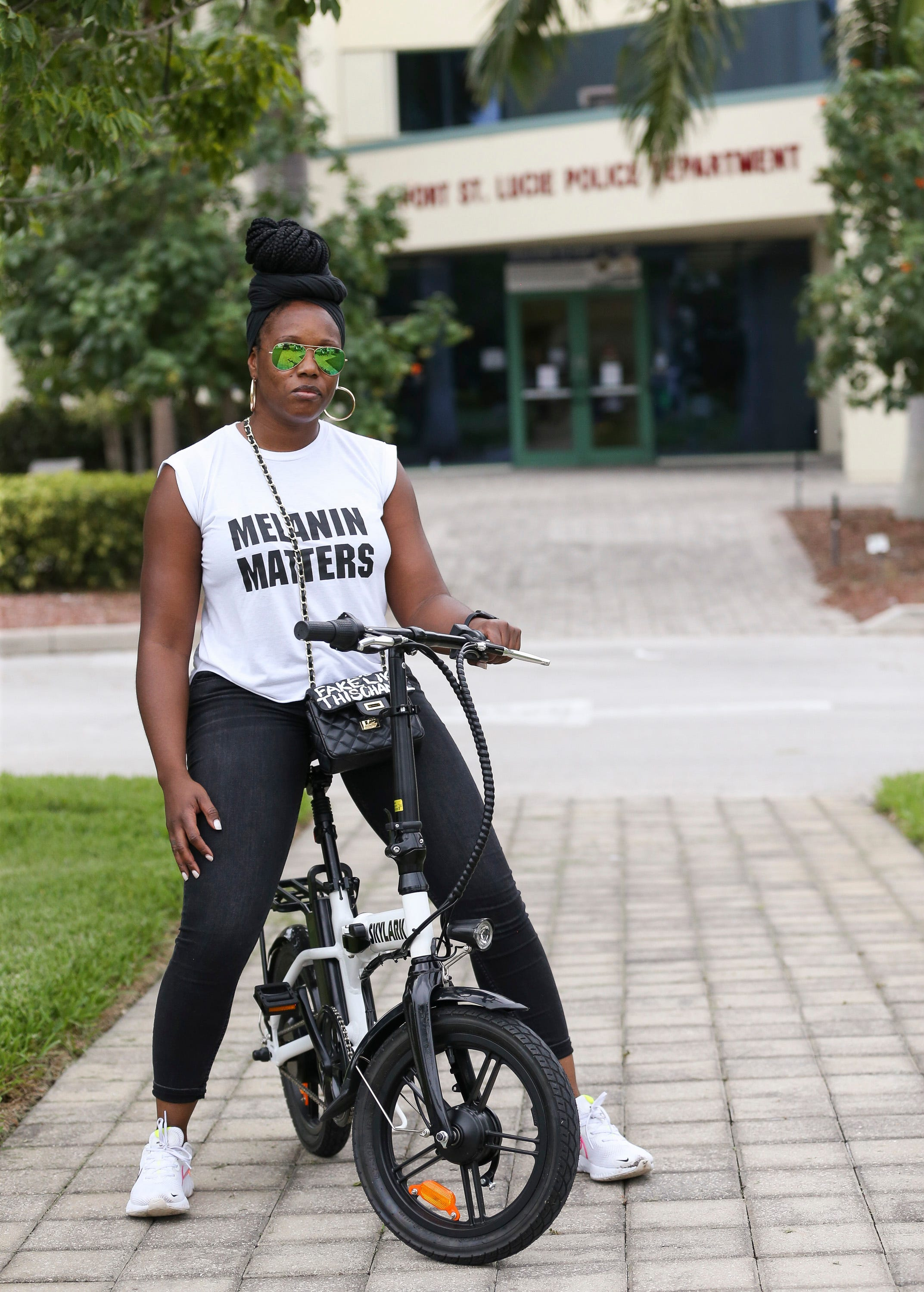 """Kenyel Day, of Port St. Lucie, attends the peace and justice demonstration at Port St. Lucie City Hall on Saturday, June 6, 2020, in Port St. Lucie. """"I come out to support,"""" said Day."""