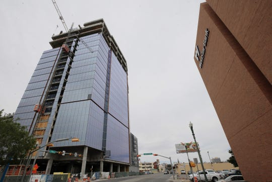 The 19-story WestStar Tower at Hunt Plaza is shown under construction along Mesa Street in Downtown El Paso, across the street from WestStar Bank's current headquarters.