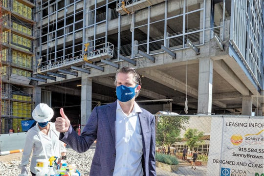 Josh Hunt, executive vice president of Hunt Cos., shows his approval at the May 21 topping-off ceremony for the 19-story WestStar Tower at Hunt Plaza in Downtown El Paso.