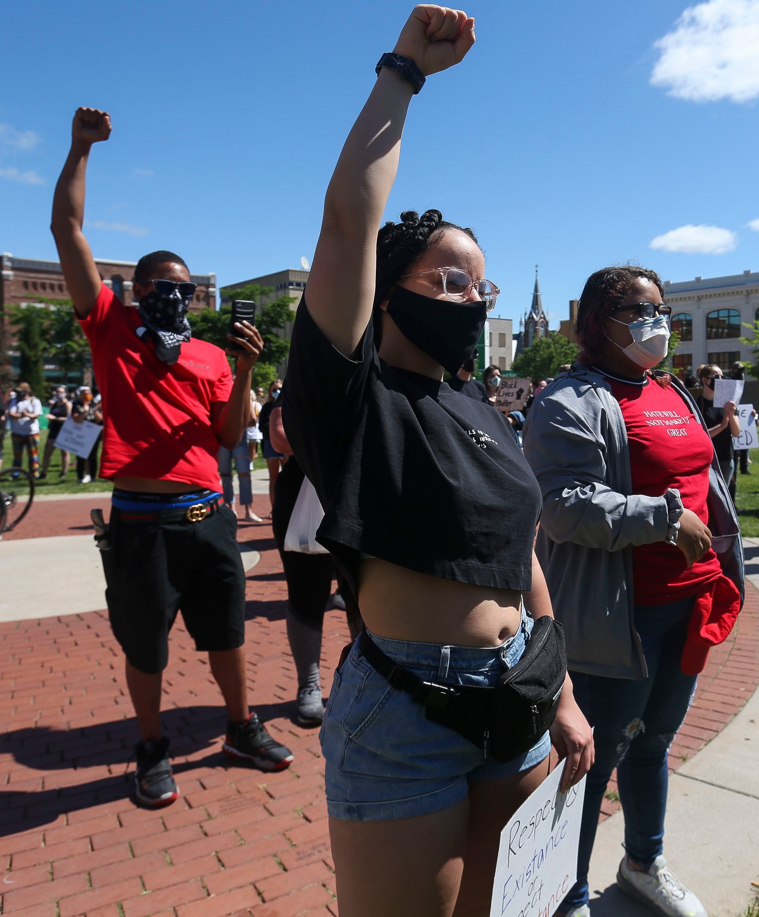 Protester Makenzie Yach raises her fist in solidarity prior to a march on Saturday, June 6, 2020, at  in Wausau, Wis. Protesters gathered and marched in response to George Floyd's death in police custody on May 25 in Minneapolis.Tork Mason/USA TODAY NETWORK-Wisconsin