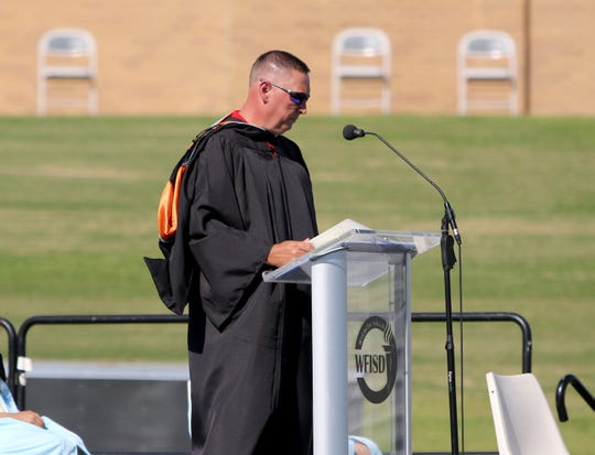 Wichita Falls ISD Superintendent Michael Kuhrt introduces Hirschi High School's valedictorian Sonya Ganeshram and salutatorian Ila Kamath Saturday, June 6, 2020, at Memorial Stadium.