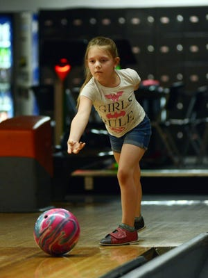 Arabella Wells, 7, rolls the ball on Friday at Sunrise Bowling Center. Sunrise recently re-opened after being closed for more than two months due to COVID-19.
