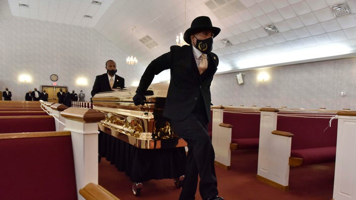 The casket carrying the body of George Floyd is brought inside before the George Floyd memorial.