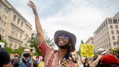 Walter Kelly chants during protests on Black Lives Matter Plaza in Washington, DC on Saturday, June 6, 2020. Protests continued following the death of George Floyd, a black man who died after being restrained by Minneapolis police officers on May 25.