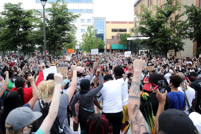 Protesters demonstrate during a Black Lives Matter protest on Saturday, June 6, 2020, at Houdini Plaza in Appleton, Wis.