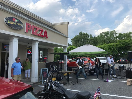 Bliss plays the parking lot of Delvetto's Pizzeria  and Pub in Neptune on June 6, 2020.