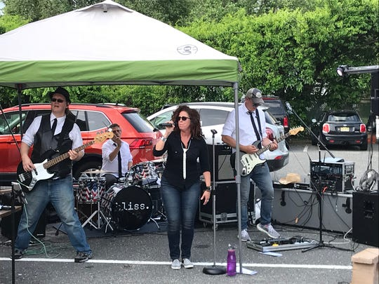 Bliss plays the parking lot of Delvetto's Pizzera and Pub in Neptune on June 6, 2020.