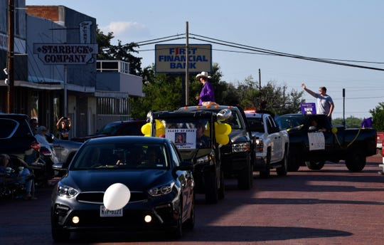 Merkel High School seniors parade through downtown Friday.