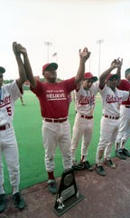 Steve Castro celebrates with the Robstown baseball team after winning the 1991 state championship.