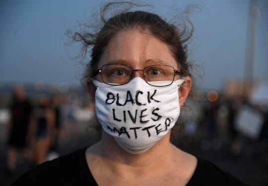 Amy Becker wears a Black Lives Matter mask during the Corpus Christi Black Leadership Standing in Solidarity event, Saturday, June 6, 2020, in downtown Corpus Christi. The group was protesting the death of George Floyd and the use of excessive force by police.