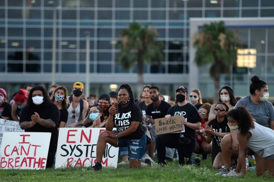 Protesters kneel during an 8-minute moment of silence during the Corpus Christi Black Leadership Standing in Solidarity event, Saturday, June 6, 2020, in downtown Corpus Christi. The group was protesting the death of George Floyd and the use of excessive force by police.