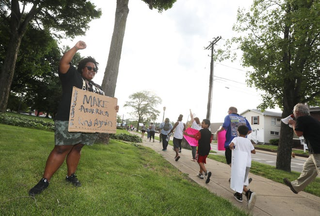Javanna Ramsey encourages protestors as they make their way around the Coshocton Court Square at a Black Lives Matter rally over the summer. Ramsey and Lucy Malenke addressed city council this week about a new group, Coshoctonians for Peace and Equality, dedicated to racial equality and education in Coshocton County.