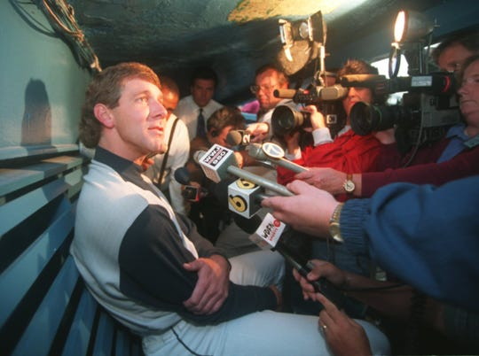 Tigers closer Mike Henneman, the team's union player rep, speaks to the media in the dugout in Tiger Stadium on Aug. 11, 1994, the last day before the players strike.