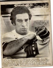 USC outfielder Steve Kemp tries on a Tigers uniform outside of his Los Angeles home after being the No. 1 overall pick in the 1976 MLB draft.