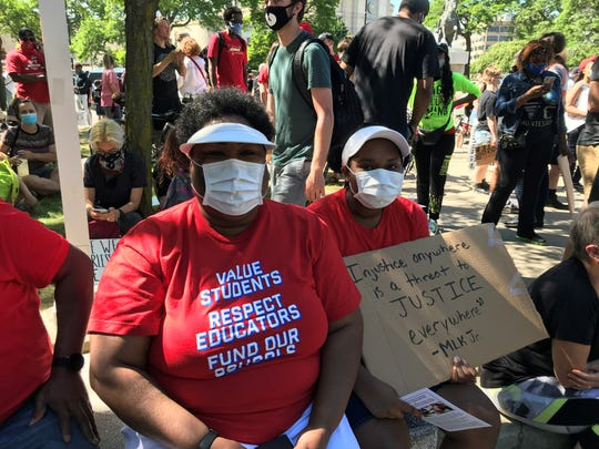 Noni Makun, who teaches in Detroit, was among several hundred teachers who joined a protest in downtown Detroit Sunday, June 7, 2020.