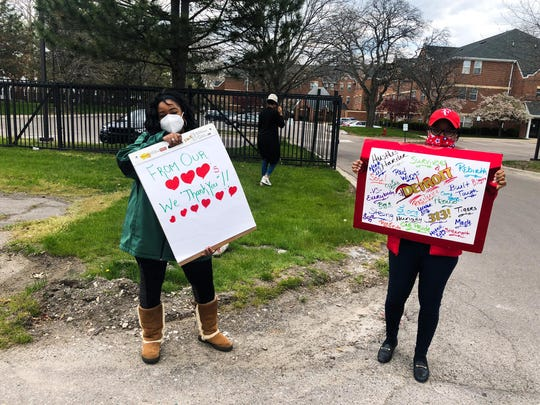 Volunteers cheer on health care workers at Hartford Nursing and Rehab Center in Detroit.