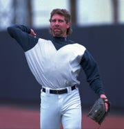 Tigers closer Mike Henneman plays catch on April 5, 1995, in Lakeland, Florida, during the first informal workout after the players ended their strike.