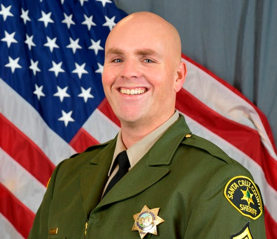 This photo provided by the Santa Cruz County Sheriff's Office shows Sgt. Damon Gutzwiller. Gutzwiller was shot and killed Saturday in Ben Lomond, an unincorporated area near Santa Cruz, Calif., when he and two other law enforcement officers were ambushed by a suspect.