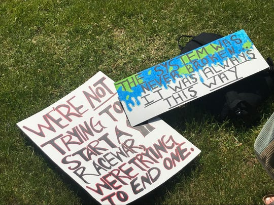 Protest signs in Leicht Park in downtown Green Bay in advance of a  social injustice protest Sunday in downtown Green Bay.