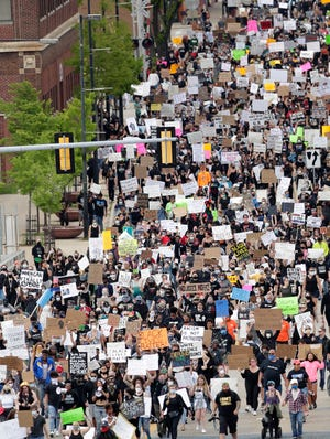 Protesters march down Walnut Street in downtown Green Bay  on June 7, 2020. Police estimate  about 1,000 people participated in the protest against police brutality in the wake of the George Floyd death on Memorial Day.
