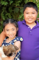 Siblings Eiana Rose, and Rique Ray are excited for the start of school at Agana Heights Elementary. Nine-year-old Rique Ray,  - diagnosed with autism since age 4, won't worry his parents much. Liz and Mony Calvo are more worried that their daughter could be emotionally affected