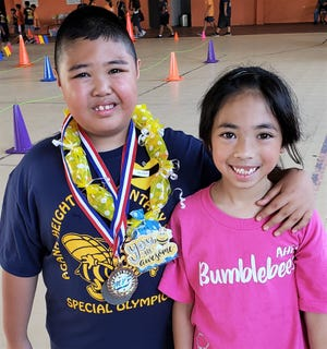 Agana Heights siblings Rique Ray Calvo, 9, at left, and his sister Eiana Rose Calvo pause for a photo during a school activity held on March 14, 2020, at the Agana Heights gym. Parents Liz and Mony Calvo aren't worried about Rique Ray, who has been diagnosed with autism since age four. They worry more about their daughter Eiana Rose, who might not be classmates with her best friend.