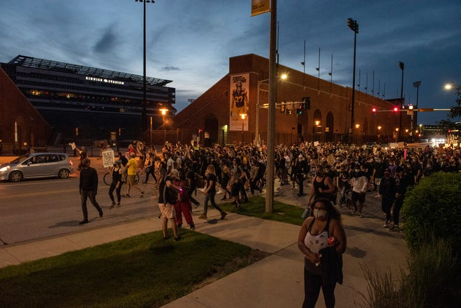 Protestors march past Kinnick Stadium as protests for racial justice entered their eighth day in Iowa City on Saturday, June 6, 2020.