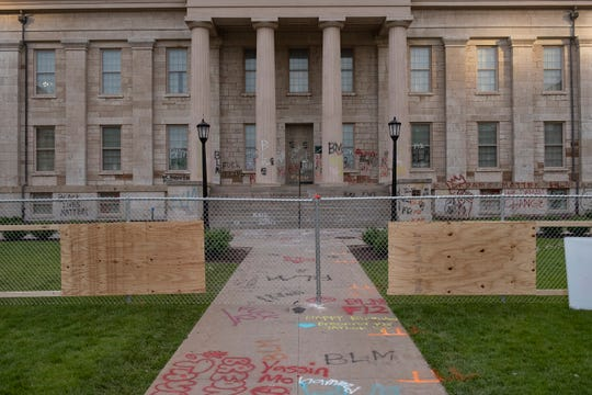 A chain-link fence blocks off the Old Capitol Building as protests for racial justice entered their eighth day in Iowa City on Saturday, June 6, 2020.