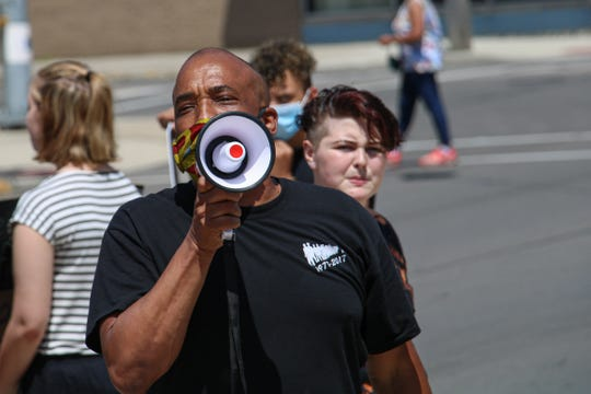 "Rev. Shawn Jackson of Mayes Community Temple Church speaks to the crowd during a Black Lives Matter protest held Saturday, June 6, 2020, in downtown Marion. Jackson said future conversations about racial issues in Marion must ""move the needle when it comes to the area of not only how people in this country see black and brown people, but how people see other people who are different from themselves. This is an opportunity for Marion, which many times gets a bad rap, to make a statement that we are going to come out on the right side of history when it comes to this type of issue."""