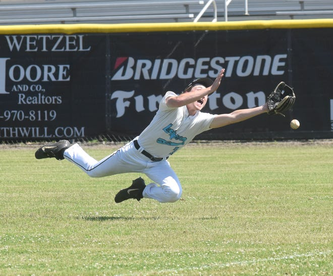 Lockeroom's Noah Everett dives for a hit down the right-field line during Saturday action at Russellville. The Mountain Home team split a pair of games to open its season.