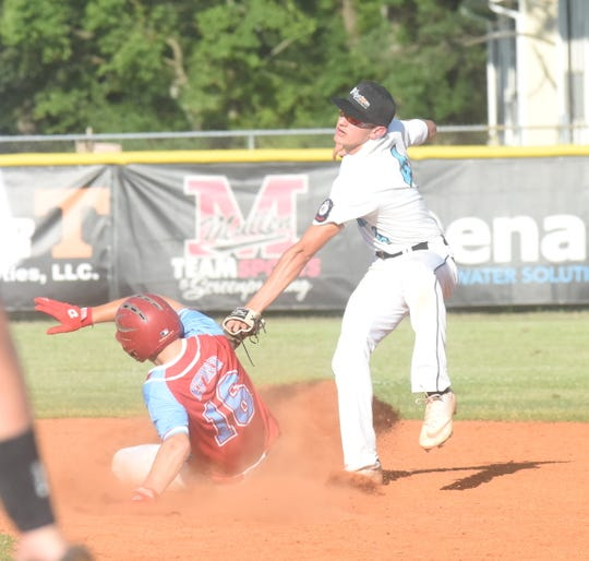 Lockeroom second baseman Chase Orf puts a tag on a Mena baserunner during action Saturday at Russellville.