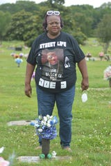 "Doe B's mother Shirley Thomas at the grave of Montgomery rapper Doe B on Saturday, June 6, 2020 at Greenwood Cemetery in Montgomery, Ala., during a video shoot for ""Street Life."""