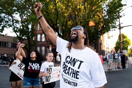 """Anthony Johnson, of Gettysburg, chants """"say his name"""" as other protesters respond with """"George Floyd"""" during a Black Lives Matter protest in the Hanover Square on Saturday, June 6, 2020."""