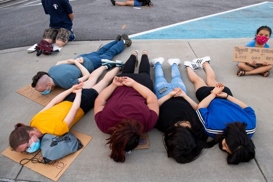 Several protester lie on their stomachs with their hands behind their backs for 8 minutes and 46 seconds during a moment of silence for George Floyd on Saturday, June 6, 2020.
