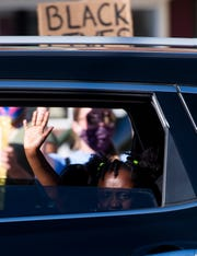 A young girl in a car waves to protesters at a Black Lives Matter demonstration in Hanover's Center Square on Saturday, June 6, 2020. Hundreds of people turned out to peacefully protest systemic racism and the death of George Floyd and other victims of police brutality.