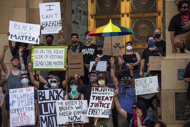 Hundreds of people march in downtown Phoenix as part of the 10th day of protests on June 6, 2020, on behalf of George Floyd, Dion Johnson, and others who were killed by police across the country. The protest was held in solidarity with protests across the country against police violence.