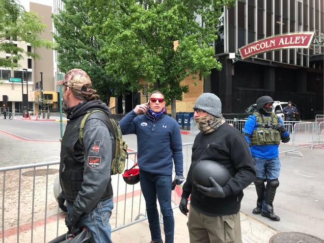 """A small group of men in tactical gear arrived to the Reno Black Lives Matter peace vigil with Joey Gilbert, a local lawyer who sued the state over the use of chloroquine for the coronavirus. They said they don't believe the police did enough last week to protect the city and were at the peace vigil """"in support"""" June 7, 2020."""
