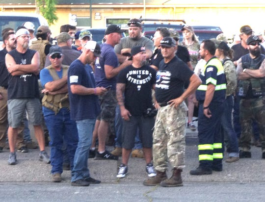 While demonstrators protested police violence against blacks on Tuesday, June 2, a group of  mostly men gathered a block away. They said they came to the rally to protect businesses from looting. The rally remained largely peaceful.
