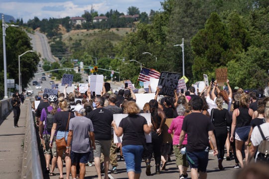 People gathered Saturday, June 6, 2020 at Caldwell Park for a rally and silent march that called for racial justice and the end to police brutality after the death of George Floyd. The Redding March for Justice drew a 1,500-strong crowd that walked Diestelhorst Bridge, the Sacramento River Trail and nearby streets.