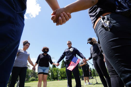 Redding Police Chief Bill Schueller joins a group Saturday, June 6, 2020, for prayer before they marched in a silent protest calling for racial justice and the end to police brutality. The Redding March For Justice was held at Caldwell Park and was in response to the death of George Floyd.