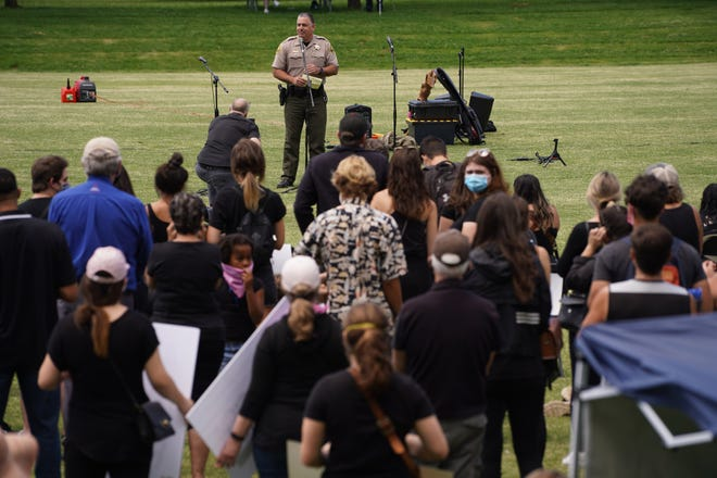 Sheriff Eric Magrini speaks at the Redding March for Justice on Saturday, June 6, 2020. The rally and silent march called for racial justice and the end to police brutality. It was held at Caldwell Park and was in response to the death of George Floyd.