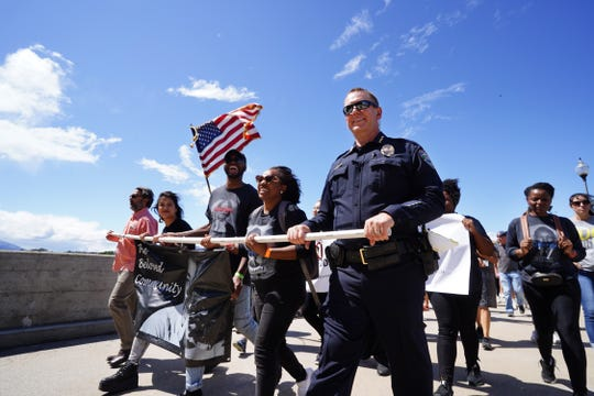 Marchers cross the Diestelhorst Bridge on Saturday, June 6, 2020 during a silent protest calling for racial justice and the end to police brutality. The Redding March For Justice was held at Caldwell Park and is in response to the death of George Floyd.