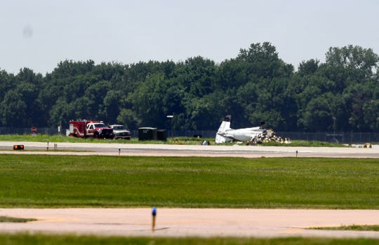 A small airplane wreck remains near the runway after it crashed flying from Sioux Falls to Huron early morning on Sunday, June 7, at Sioux Falls Regional Airport. The pilot died in the crash.