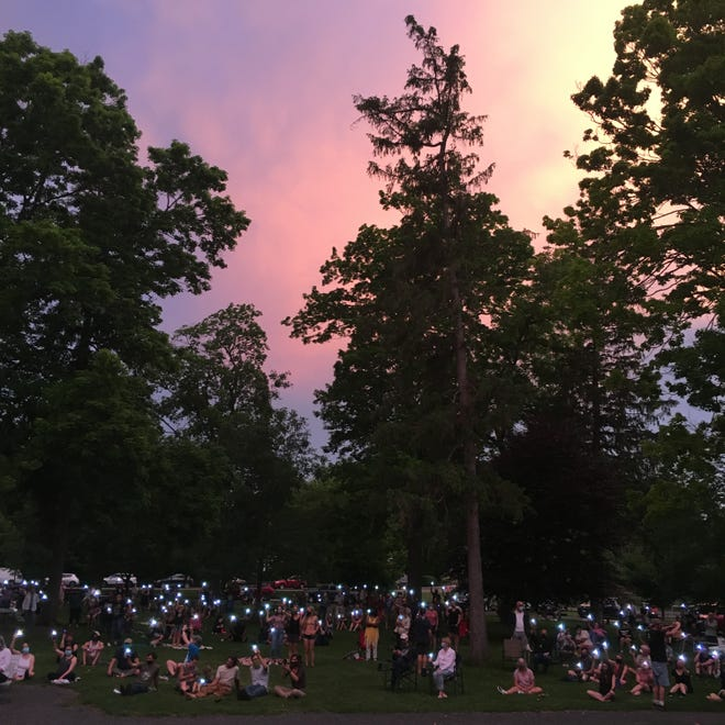 The Prayer Vigil for Justice ended with the crowd of several hundred holding their cellphone flashlights aloft as the sun set.