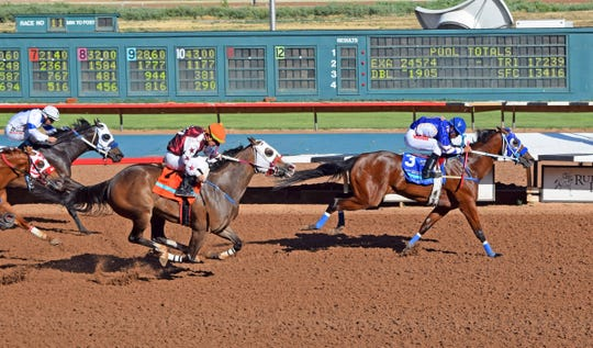 Hotsempting won the Grade 1, 400-yard Ruidoso Derby on Saturday. It was her first Grade 1 win.