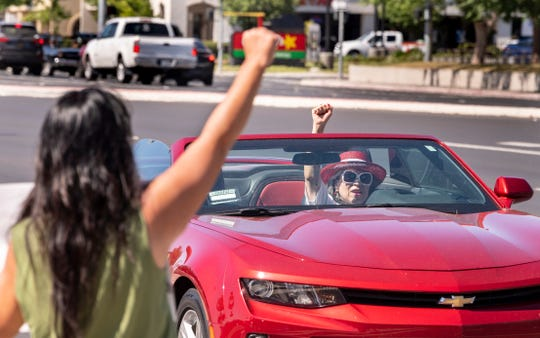 Passing motorists show their support for protesters gathered Saturday, June 6, 2020 to support Back Lives Matter at Mooney Boulevard and Caldwell Avenue.