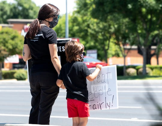 Amber McAuley and her son Arlo McAuley, 5, of Visalia stand with protesters gathered Saturday, June 6, 2020 to support Back Lives Matter at Mooney Boulevard and Caldwell Avenue.