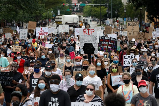 Protesters fill College Avenue during the Athens Anti Discrimination Movement 'Justice For Black Lives Rally' in downtown Athens, Ga, on Saturday, June 6, 2020.
