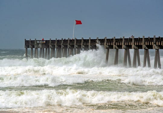 Waves kicked up by Tropical Storm Cristobal crash around the Pensacola Beach Pier on June 7, 2020.
