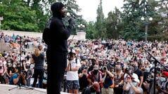 Von Miller addresses demonstrators at a rally in Denver on Saturday.